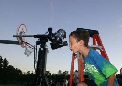 outreach kid on ladder